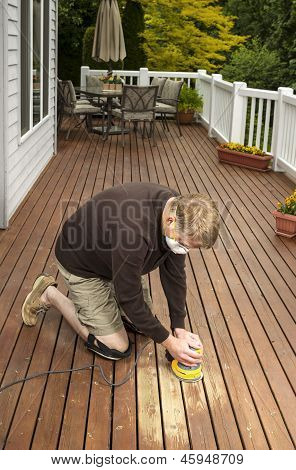 Mature Man Working On Natural Cedar Deck