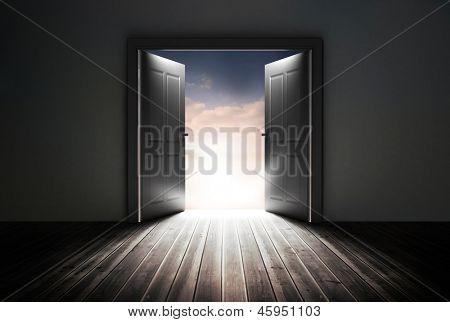 Doors opening to reveal beautiful sky in dark grey room