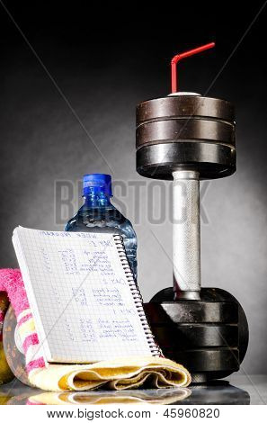 sport nutrition. metal barbells with red straw