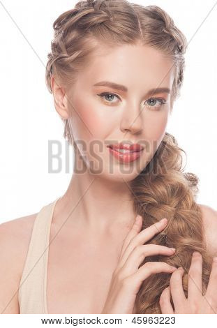 Blond Hair. Young Beautiful Caucasian Woman with Hairstyle Tress and Makeup. Isolated on white background