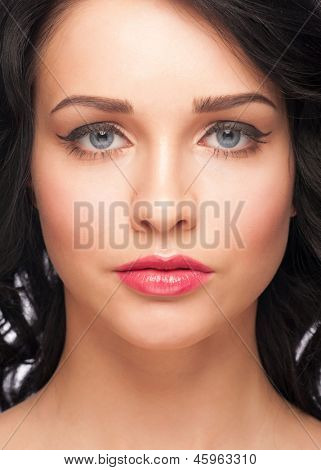 Portrait of attractive young woman with stylish bright makeup with black eyeliner
