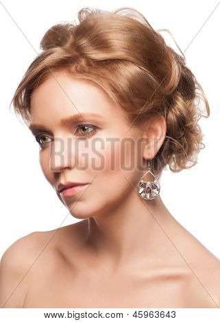 Portrait of attractive young woman with makeup and  beautiful hairstyle