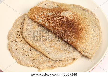 Homemade North Staffordshire oatcakes, a regional English delicacy with something approaching a cult following. These pancakes mix white, wholemeal and oatmeal flour and are leavened with yeast