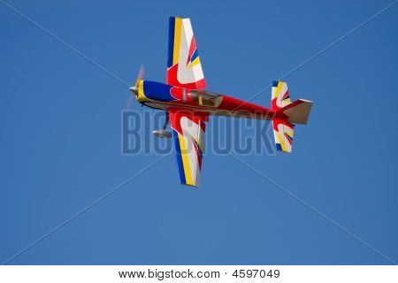 An Rc Model Airplane Doing A Tight Turn To The Left