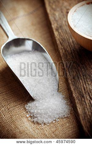 white salt in metal scoop