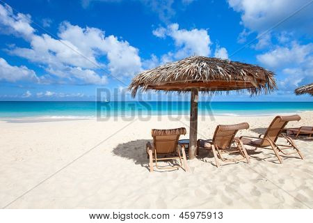 Chairs and umbrella on a beautiful tropical beach at Anguilla, Caribbean