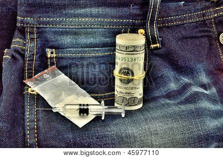 White Powder Dollars And Syringe On Jeans