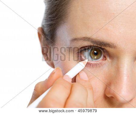 Closeup On Woman Using White Eye Liner