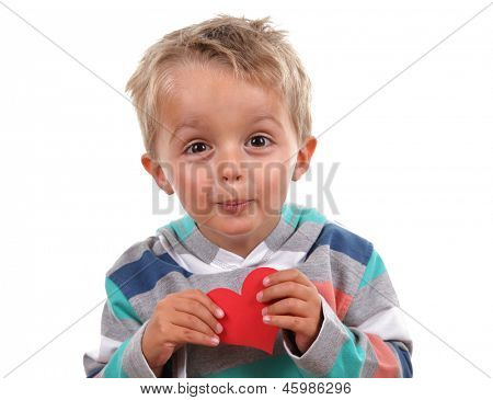 Little boy holding a valentine's heart he has made