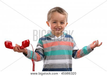 Boy shrugging and gesturing whatever with his hands after an unknown telephone call
