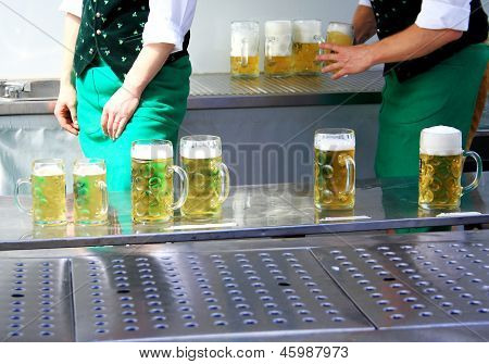 Fresh Draft Beer At Oktoberfest And Two Worker