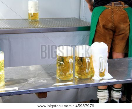 Fresh Draft Beer At Oktoberfest And One Worker