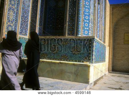 Veiled Shia Women Walking In Front Of Mosque's Mosaic Walls,