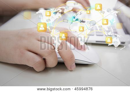 Social networking concept : Closeup of business woman hand typing on laptop keyboard with mouse