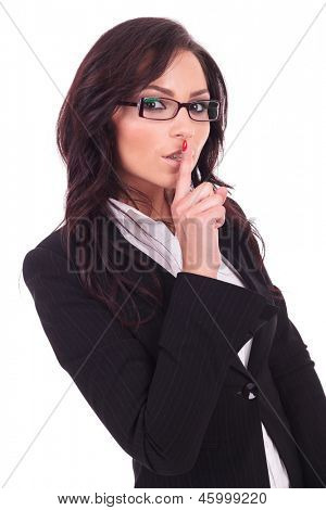 young business woman making the shut up gesture with her finger at her mouth. on white background
