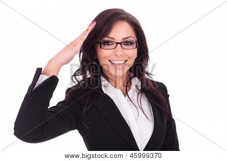 young business woman saluting you in a military style. on white background