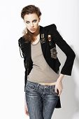Individuality. Beautiful Eccentric Fashion Model In Jeans And Bijou On Jacket poster