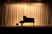 stock photo of grand piano  - Grand piano at concert stage with brown curtain - JPG