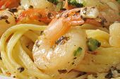 pic of sauteed  - Closeup of shrimp scampi with sauteed garlic lemony sauce and broccoli - JPG