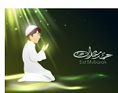 Arabic Islamic Calligraphy of text Eid Mubarak with Muslim boy in tradition outfits reading Namaj (