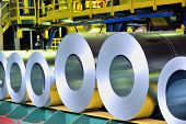 stock photo of ironworker  - rolls of steel sheet in a plant - JPG