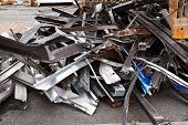 pic of scrap-iron  - Scrap metal waste of iron and aluminum for recycling at a demolished building site - JPG