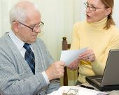stock photo of real-estate agent  - Senior client and woman agent holding an agreement togetherness - JPG
