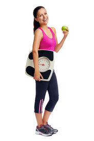 stock photo of indian apple  - healthy diet eating woman with scale and apple for weightloss - JPG