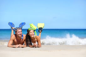 stock photo of fin  - Beach travel couple having fun snorkeling - JPG