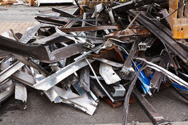 picture of scrap-iron  - Scrap metal waste of iron and aluminum for recycling at a demolished building site - JPG
