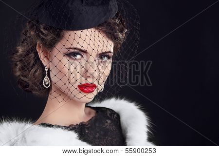 Portrait Of Of Elegant Retro Woman Wearing Little Hat With Veil