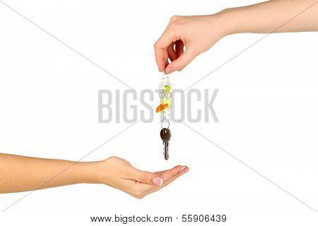 Transfer of house keys isolated on white