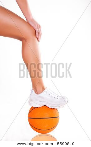 Women Bare Legs And Sneakers With Basket Ball