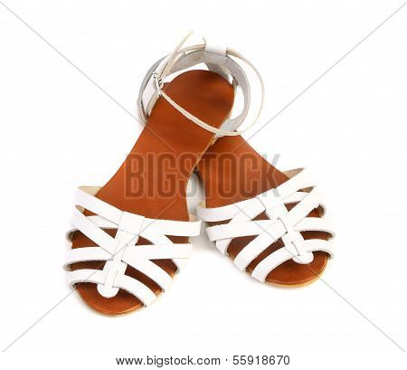 Pair of white leather female sandals