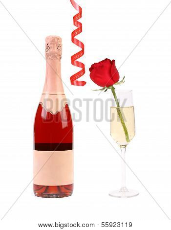 Bottle of champagne and glass with rose.