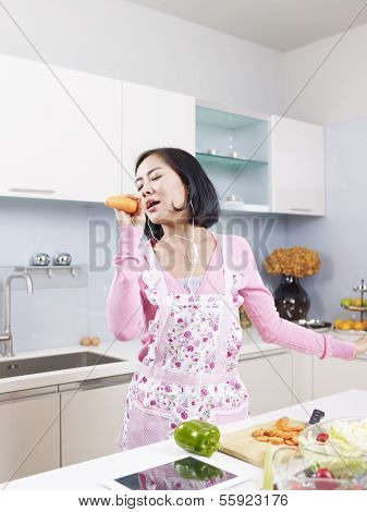 Asian Housewife In Kitchen