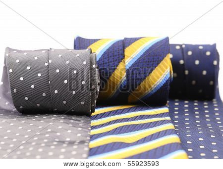 Three rolled up neckties.