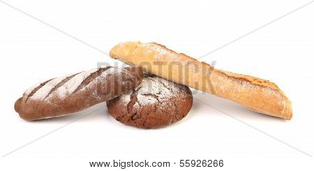 Two brown and one white breads.