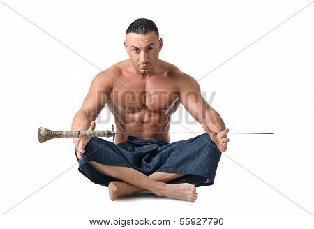 Muscular Man Sitting On The Floor With Japanese Sword
