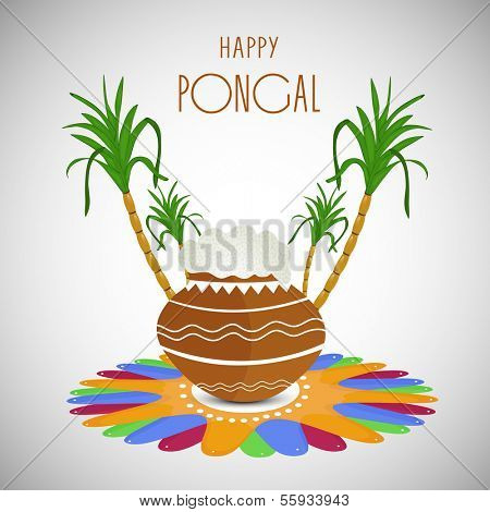 Happy Pongal, harvest festival celebration in South India with pongal rice in a traditional mud pot and sugarcane's on floral (rangoli) decorated background.