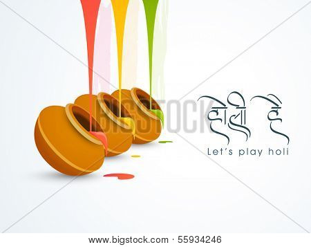 Indian color festival Holi concept with traditional mud pots with full of colors and text Holi Hai on grey background.