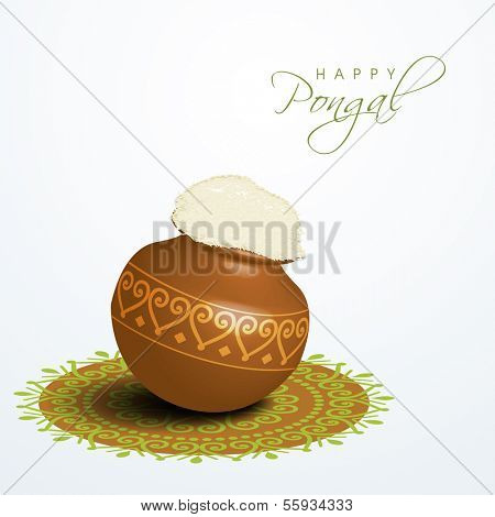 Happy Pongal, harvest festival celebration in South India with pongal rice in a traditional mud pot on beautiful floral (rangoli) decorated background.
