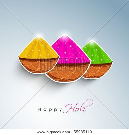 Indian festival Happy Holi celebration concept with shiny dry colors (gulal) baskets on blue background.