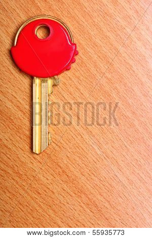 House Key With Red Plastic Coats Caps On Table