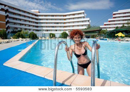 Woman In Hotel's Pool