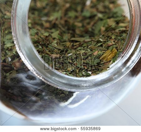 Close Up Jar With Lovage Spice Isolated