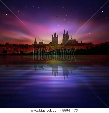 Abstract Background With Silhouette Of Koln And Sunset