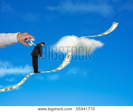 Businessman Standing On Growing Money Trend With Hand Winding I