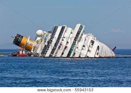 Giglio, Italy - April 28, 2012: Costa Concordia Cruise Ship At Italian Giglio Island Coastline After