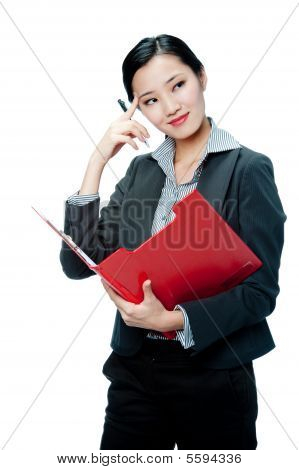 An Attractive Businesswoman With Clipboard